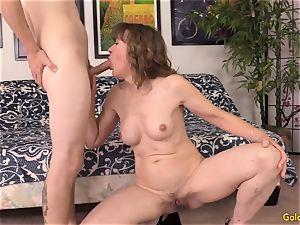 Mature babe Morgan works a fuckpole