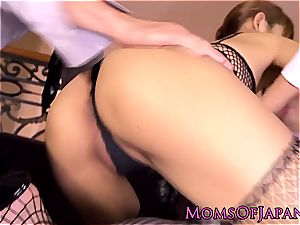 chinese mummy in fishnets plays with her tight rosy snatch