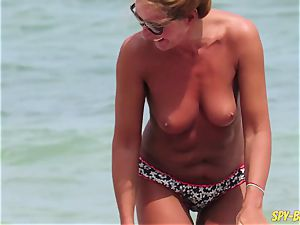 bra-less fledgling cougars - spycam Beach Close-Up